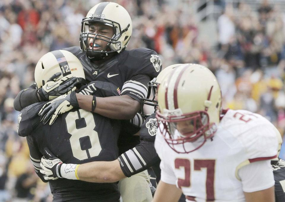 Army celebrates the winning TD by Trent Steelman (8) next to dejected BC defender Justin Simmons.