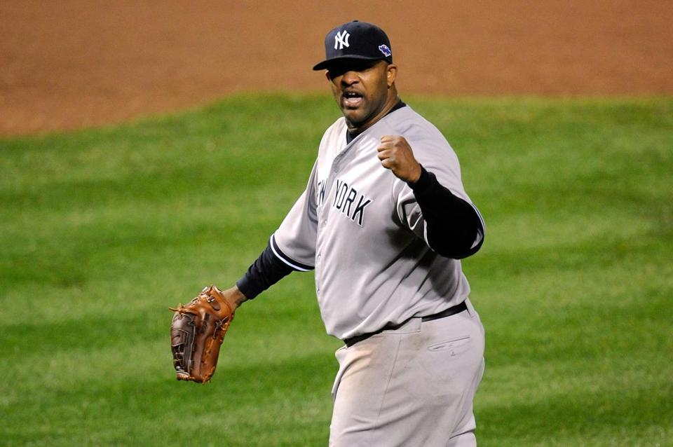 CC Sabathia allowed two runs and eight hits in 8 ⅔  innings to help the Yankees take the edge off the Orioles' first home playoff game since 1997.