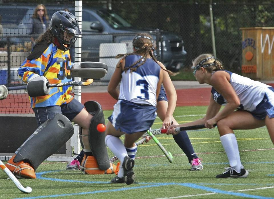 Brooke Matherson (right) slips her second of three goals past Andover's Andrea Pennock.