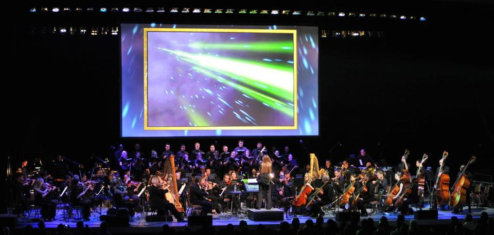 """The Legend of Zelda: Symphony of the Goddesses"" performance features video game graphics as the orchestra performs."