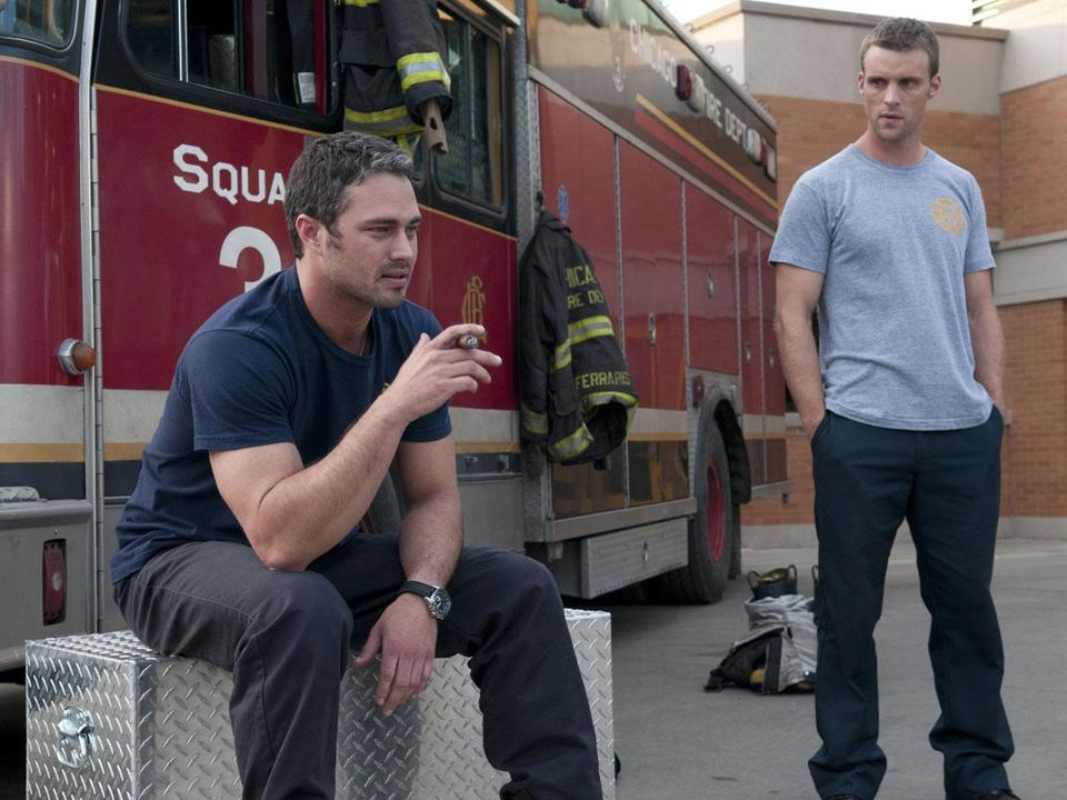 Taylor Kinney (left), as Kelly Severide, and Jesse Spencer, as Matthew Casey, enjoy some down time at the fire station.