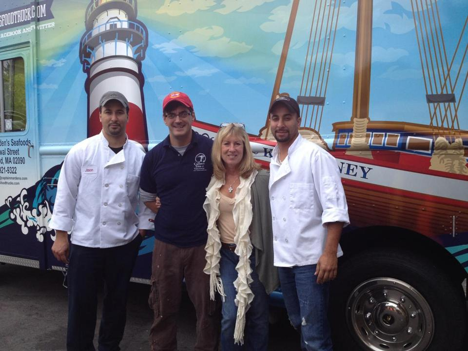 The Cod Squad staff poses with their mobile restaurant.truck is a presence in Natick, Needham, and Wellesley. From left are: Jackson Oliveira, Adilson Decosta, Terri Klippert Beal, and Jason Oliveira.