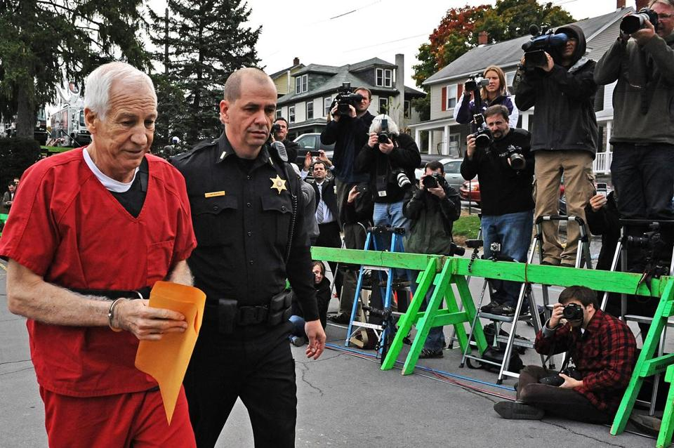 Former Penn State assistant football coach Jerry Sandusky was escorted into a Pennsylvania courthouse on Tuesday before being sentenced for his child sex abuse conviction.