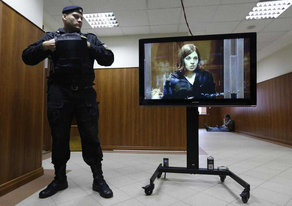 Nadezhda Tolokonnikova is shown on a TV outside the courtroom where she sought her release. She was denied.