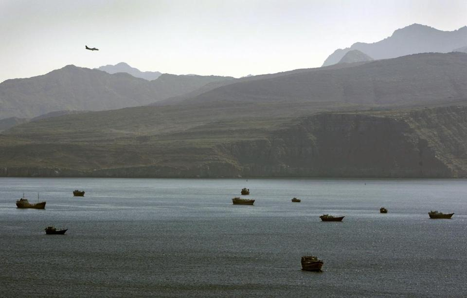 AMERICA'S ADOPTED NEIGHBORHOOD: A plane flies over the mountains south of the Strait of Hormuz.