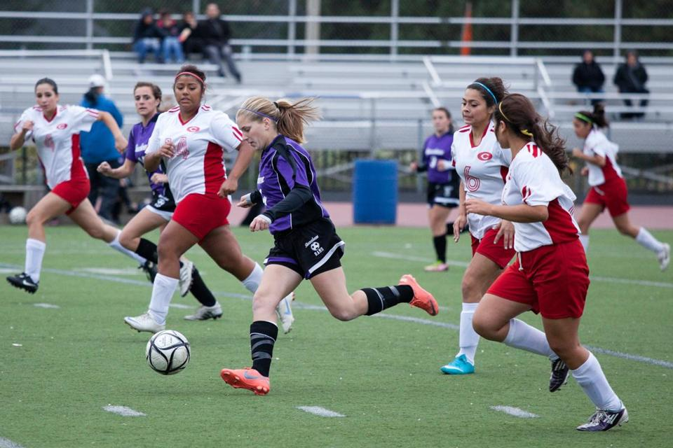 Shawsheen soccer forward Arianna Medeiros dribbles through a sea of defenders in a match against Chelsea High.