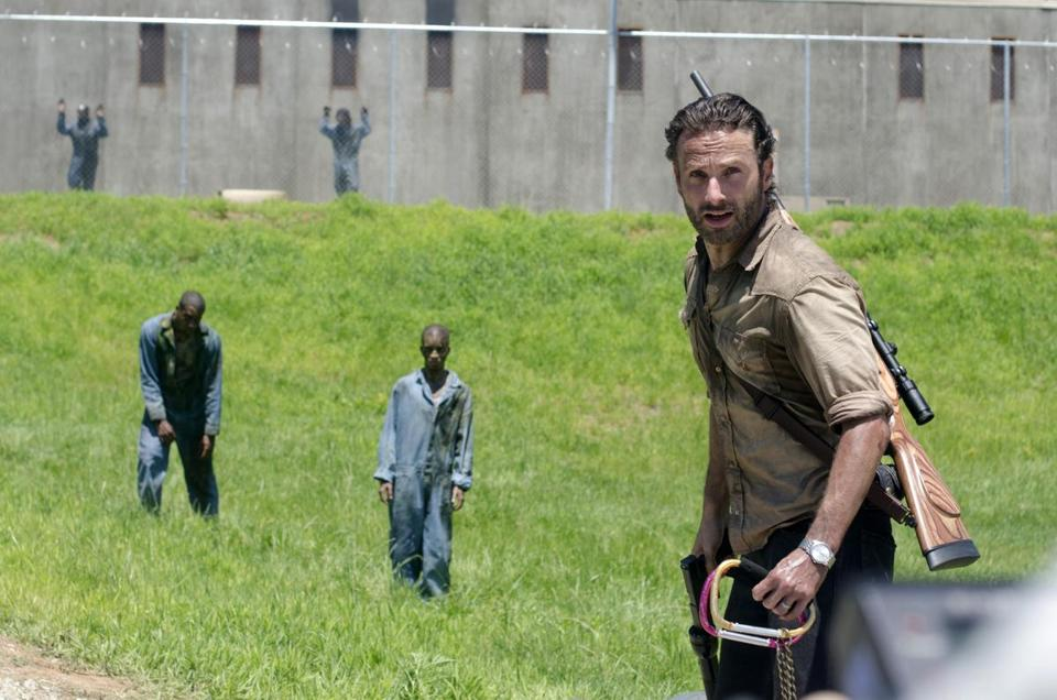 "Andrew Lincoln (right) as Sheriff Rick Grimes in a scene from the season three premiere episode of ""The Walking Dead."""
