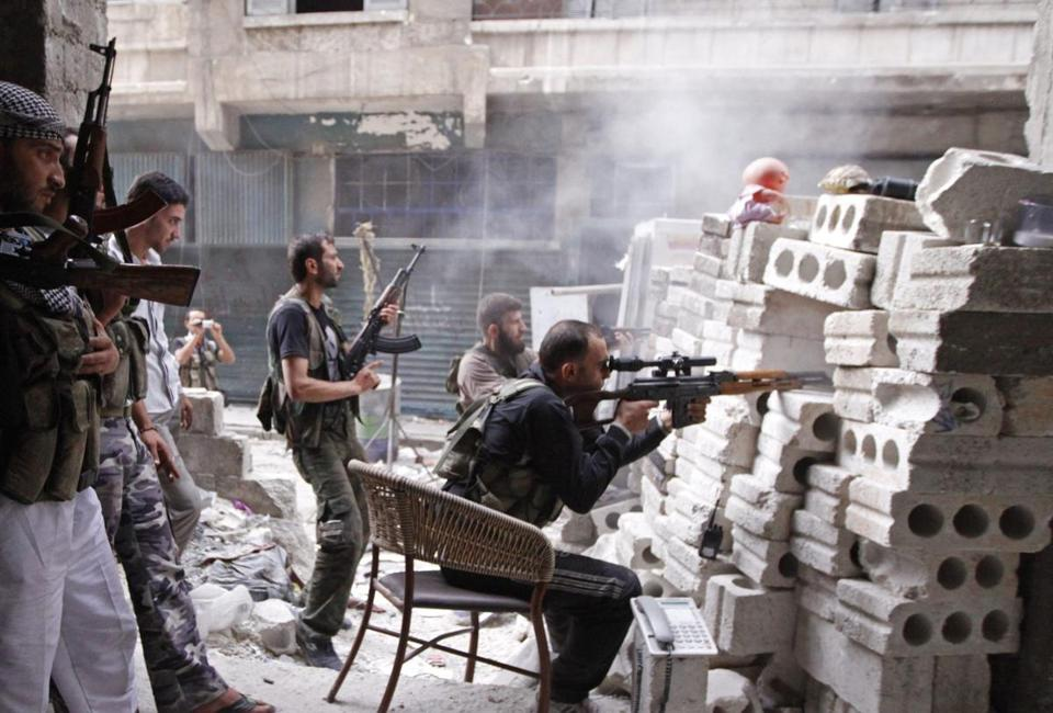 Free Syrian Army rebels fought in Aleppo in northern Syria on Thursday. Tensions between Syria and Turkey have risen over a suspected arms shipment.