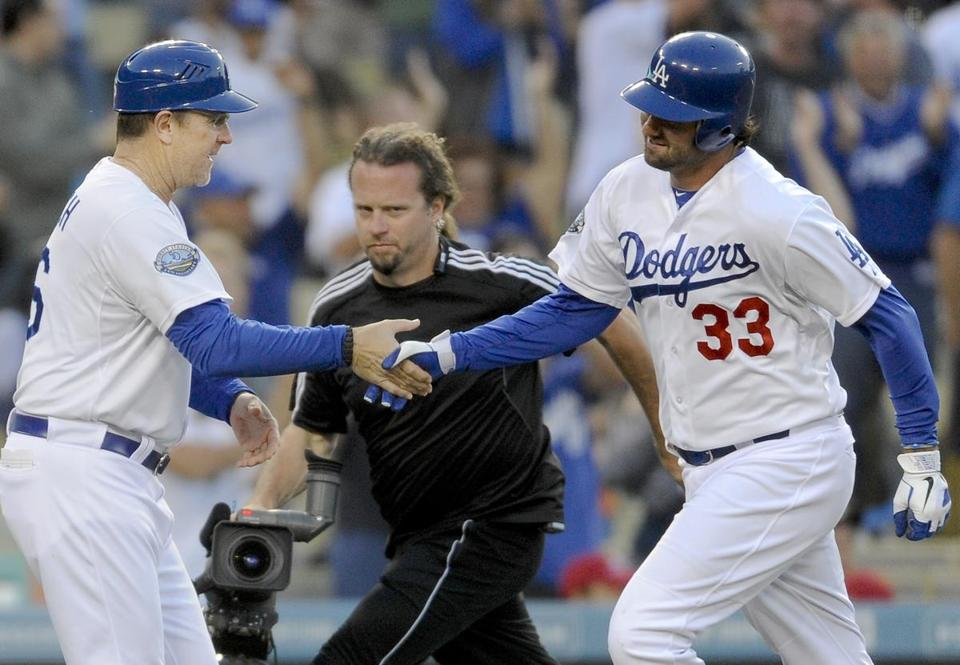 Dodgers third base coach Tim Wallach (left) congratulated Scott Van Slyke after a home run against the Cardinals in May.