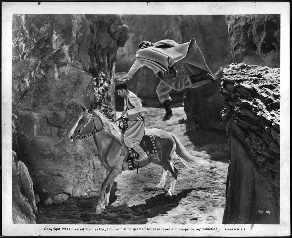 "Turhan Bey (on horse) in ""Ali Baba and the Forty Thieves."""