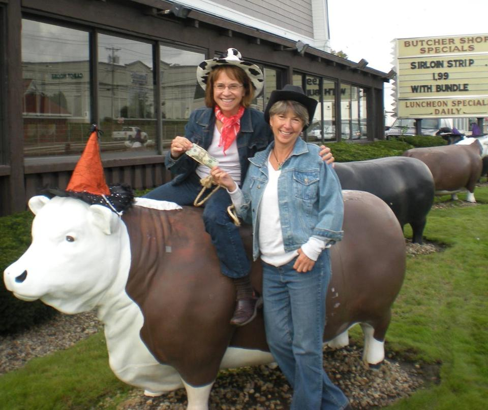 Gail Shevlin (left) and Sue Tracy found $20 hidden under a Hilltop Steakhouse cow.