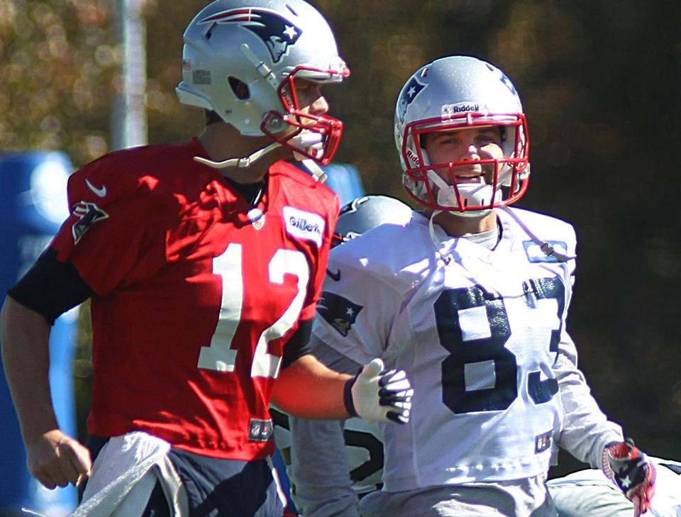 Fun-loving receiver Wes Welker (right) enjoys playing pranks on and taking jabs at teammates, especially Tom Brady (left).