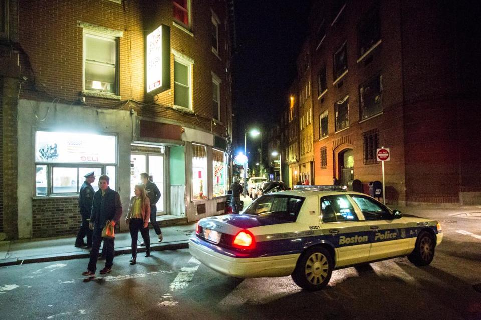 Two Boston police officers patrolled at 2:30 a.m. in the still-lively  North End this month.