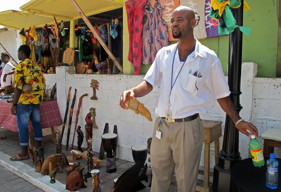 Street vendor Paul Davy sells wooden statues to tourists who stop in Falmouth, Jamaica, on cruise ships.