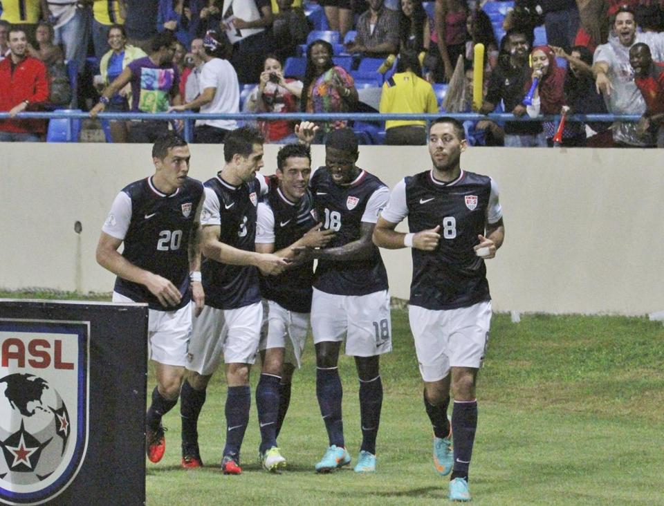 Eddie Johnson (18) celebrates the first of his two goals as the US team moved closer to qualifying for the 2014 World Cup.