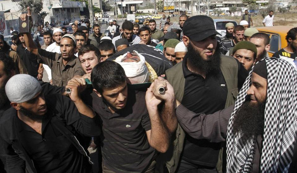 Palestinian mourners carried the body of Salafi militant Hisham Saidani during his funeral in Bureij refugee camp, central Gaza Strip, on Sunday.