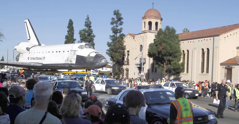 Endeavour, viewed by flocks of spectators, inched along Martin Luther King Boulevard in Los Angeles Sunday at 2 miles per hour, on its way to the California Science Center.