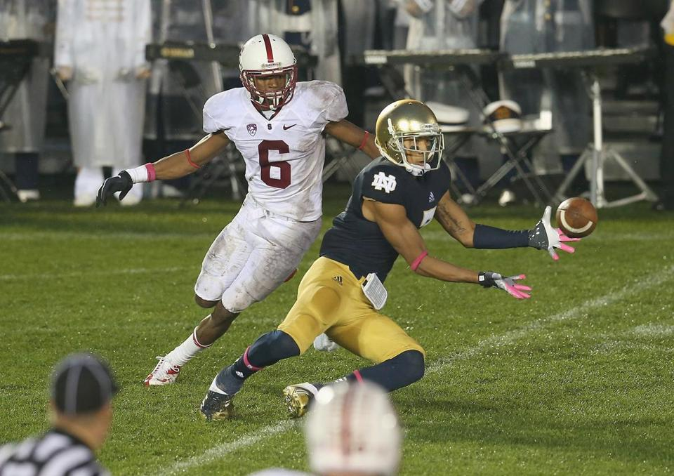 TJ Jones pivots in front of Stanford's Terrence Brown and catches the winning TD in overtime for Notre Dame.