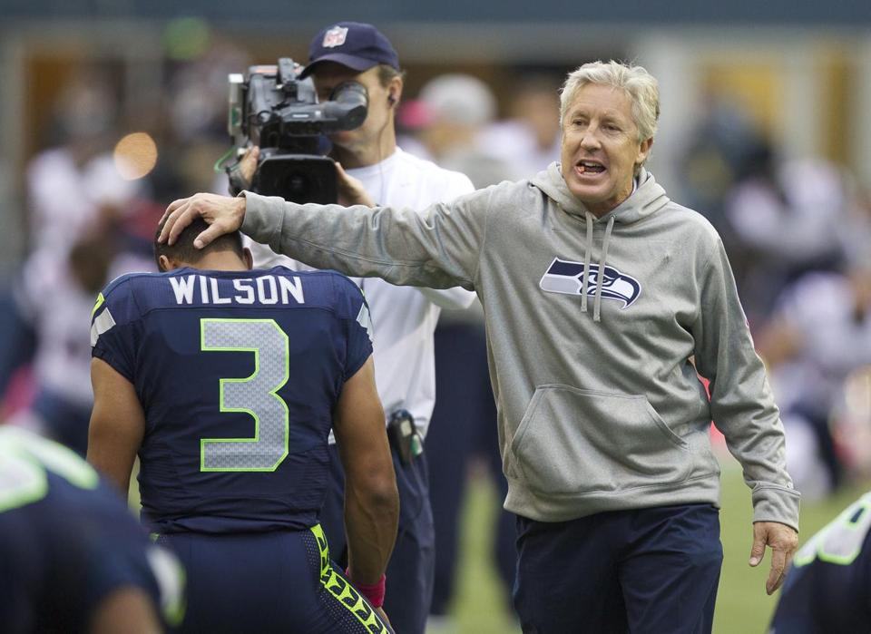 Seahawks head coach Pete Carroll patted quarterback Russell Wilson on the head before the game against the Patriots.