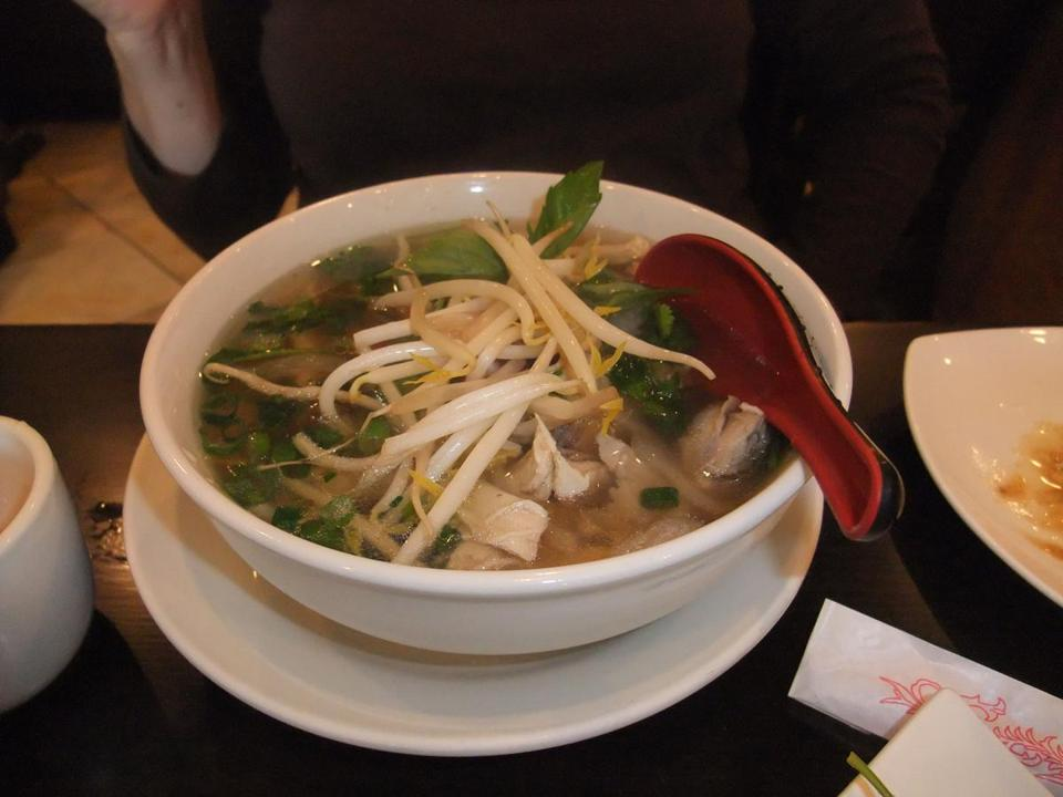 The pho ga at Pho Countryside is a chicken soup with rice noodles, garnished with basil, bean sprouts, and lime.
