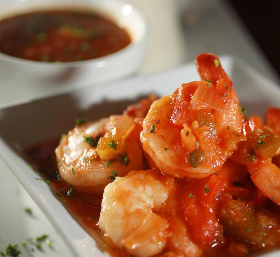 Shrimp in Creole sauce with rice and beans.