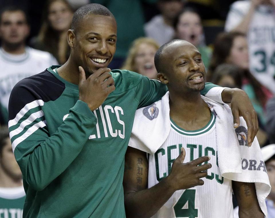 Paul Pierce (left) laughed with teammate Jason Terry during a timeout in the fourth quarter.)