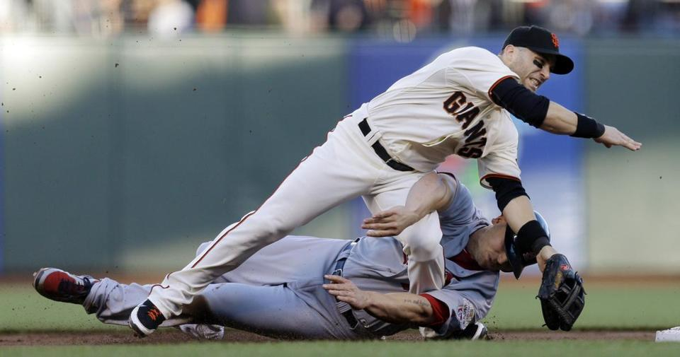 Giants second baseman Marco Scutaro injured his hip on this slide by the Cardinals' Matt Holliday on Monday.