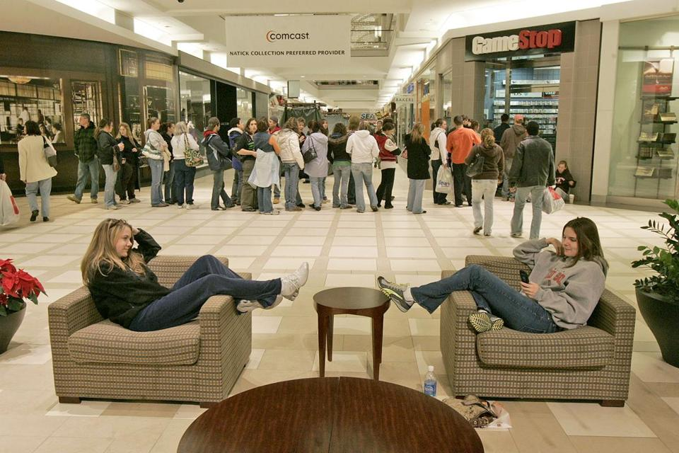 Early risers taking advantage of 6 a.m. shopping in Natick on Black Friday in 2007 waited in line outside a Game Stop.