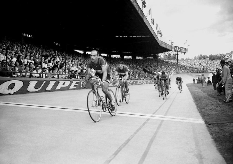 Fiorenzo Magni (left) winning a stage in Paris during the 1953 Tour de France.