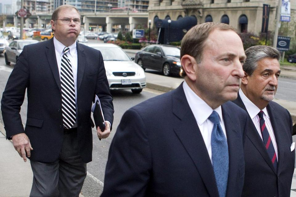 "Commissioner Gary Bettman (center) said the owners' offer was the ""best we could do.''"