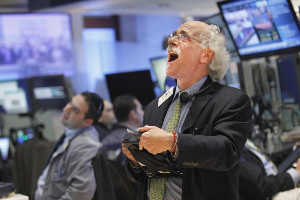 A trader reacted at the closing bell of the New York Stock Exchange Friday. The Dow closed at 13,343.51, down 205.43.