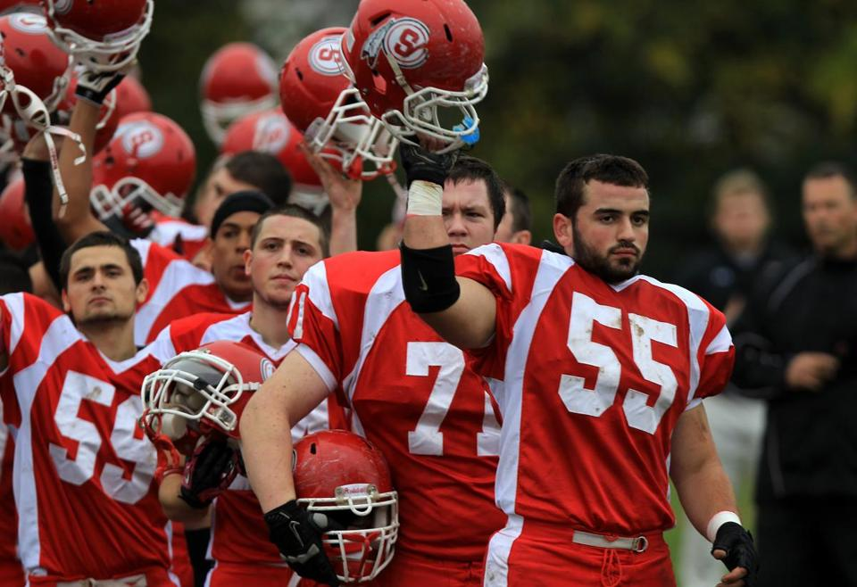Senior linebacker Tommy Trainor (55) and his Saugus teammates during last week's game against Newburyport.