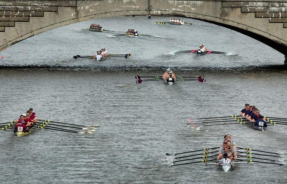 The alumni men's eights row under the Western Avenue Bridge on Day One of the Head of the Charles.