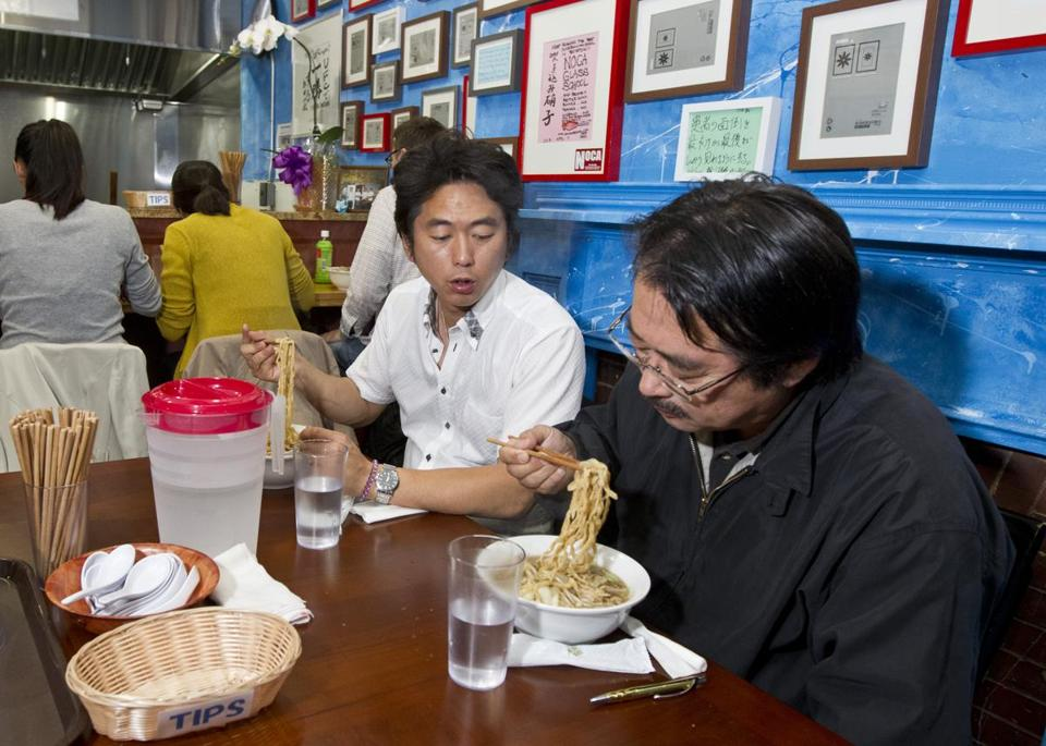 Hirotaka Yamashita (top left) and his father, Hideyuki Yamashita, eat ramen at Yume Wo Katare in Cambridge's Porter Square. Chef and owner Tsuyoshi Nishioka (left) prepares a bowl of the restaurant's sole offering (right).