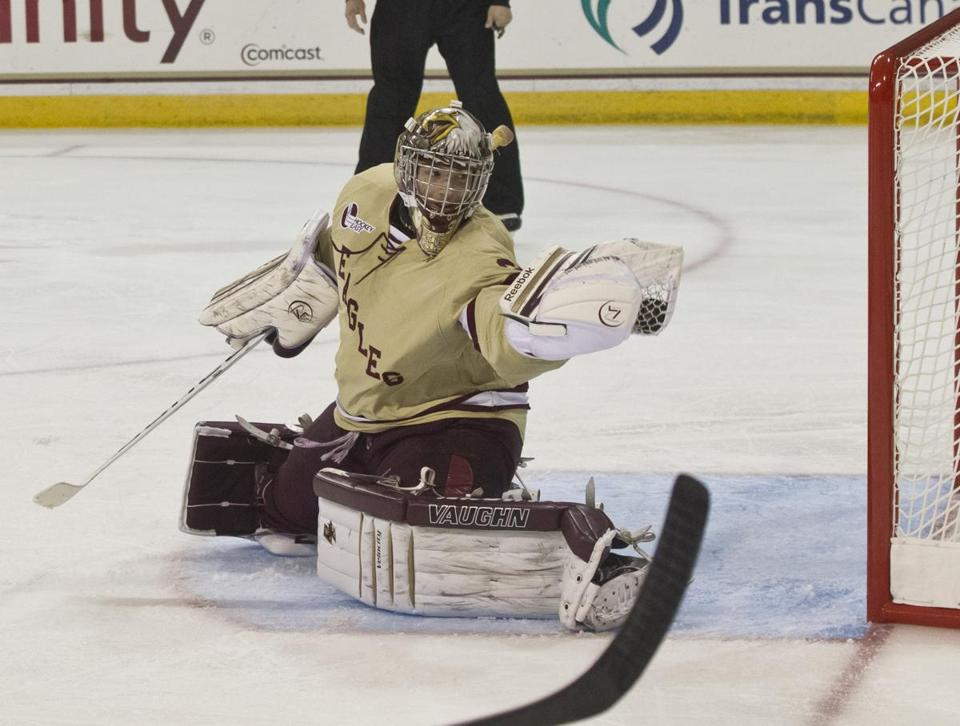 BC goalie Parker Milner flashes out the glove to make one of his 26 saves.