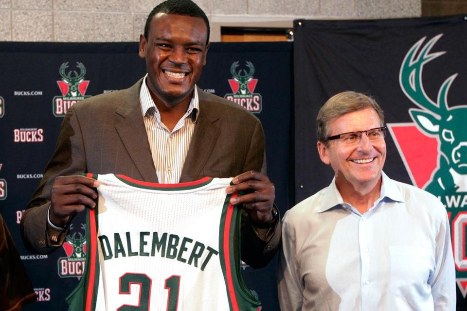 Bucks center Samuel Dalembert, left, with general manager John Hammond.