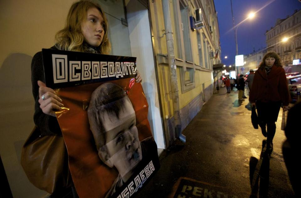 A supporter in Moscow held a poster urging the release of Konstantin Lebedev, one of the jailed opposition activists.