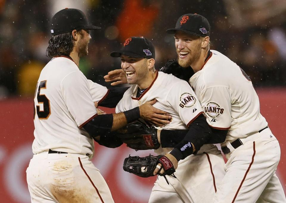 Marco Scutaro, who went 14 for 28 in the NLCS and was the MVP, is the center of attention for Giants Brandon Crawford (left) and Hunter Pence.