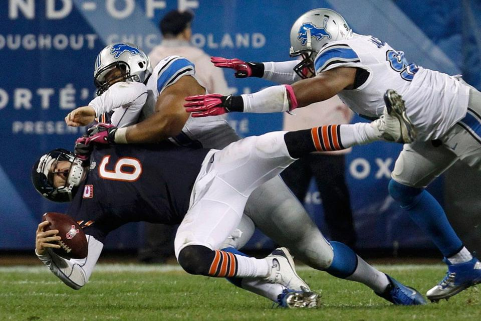 Ndamukong Suh drives the Bears' Jay Cutler down and out of the game — but Cutler returned a play later.