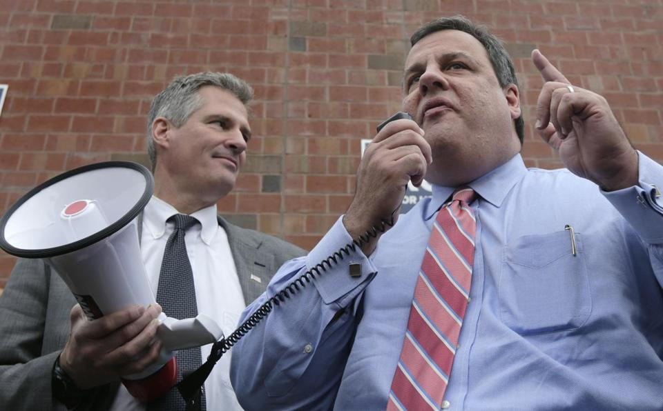 New Jersey Gov. Chris Christie stands with U.S. Sen. Scott Brown at a campaign stop for Brown in Watertown, Mass., Wednesday.