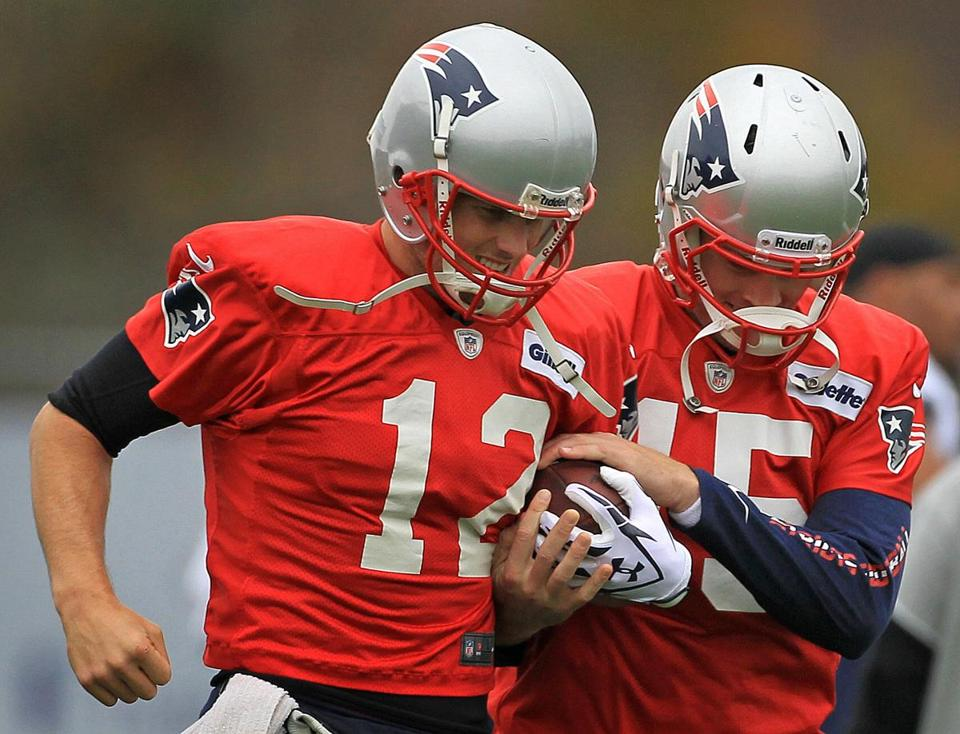 With Tom Brady, left,  at the controls, the Patriots have averaged 427.6 yards over the last 16 regular-season games.