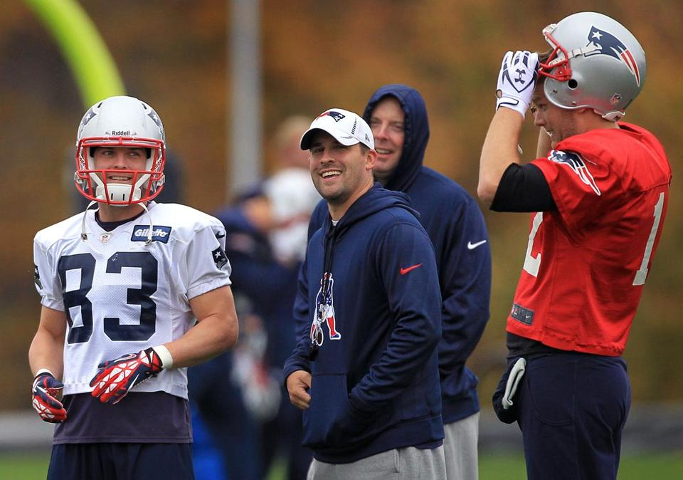 Wes Welker, left, Josh McDaniels, center, and Tom Brady will attempt to beat the Rams in London on Sunday.