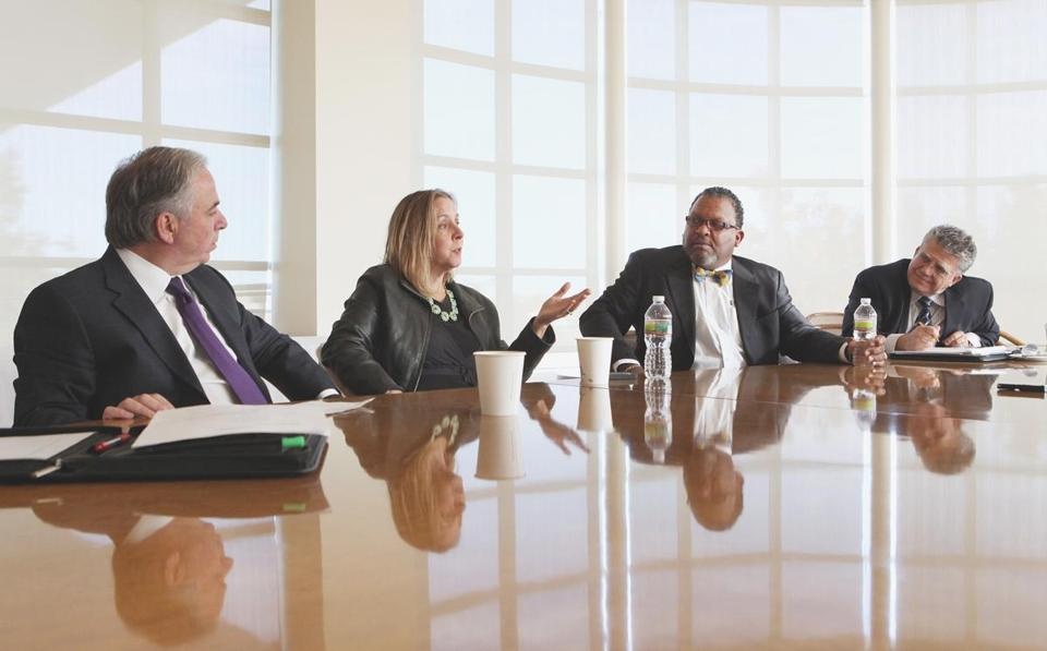 (Left to right) Paul Bardaro, partner at Malden accounting firm Rucci, Bardaro & Barrett P.C.; Meredith Flynn-Ripley, chief executive of Media Friends Inc. of Cambridge; Gordon Thompson, chief executive of Westnet Inc. of Canton; and Alberto Calvo, chief executive of Stop and Compare Supermarkets.