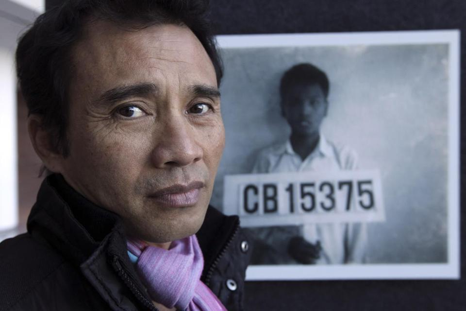 Arn Chorn-Pond at a photo exhibit of Cambodian war refugees at the John Joseph Moakley US Courthouse.