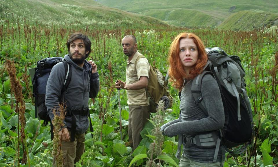 "Gael Garcia Bernal (left), his fiancee, Hani Furstenberg, and their guide, Bidzina Gujabidze, trek in the Georgian Caucasus in writer-director Julia Loktev's ""The Loneliest Planet."""