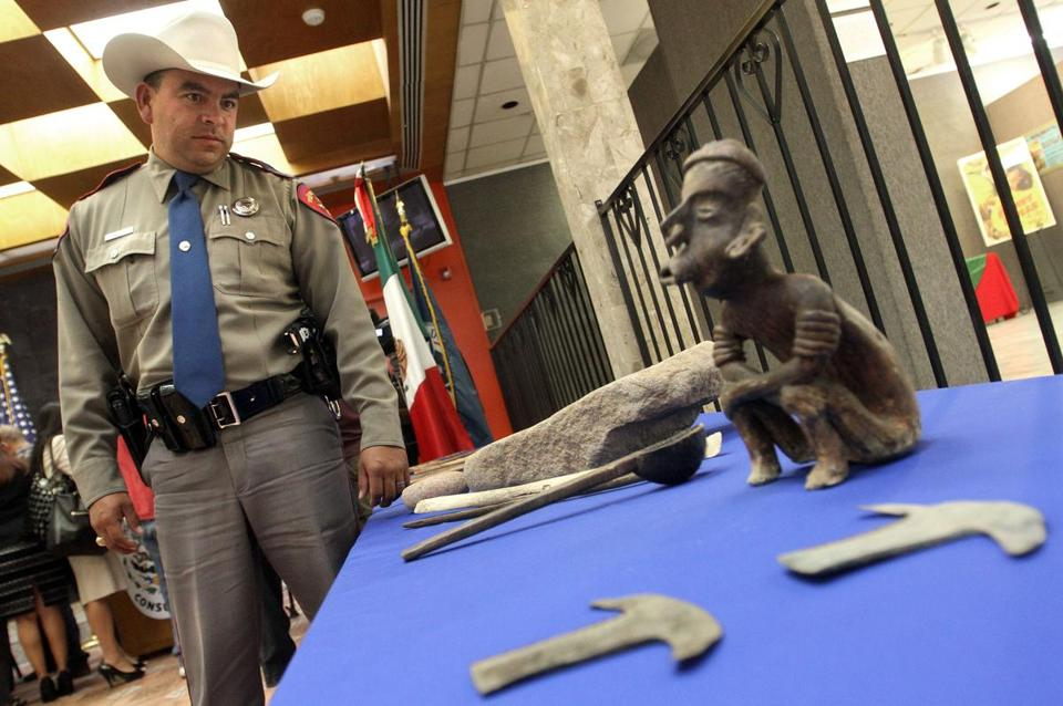 Trooper John Albert Barragan looked at artifacts during a news conference at the Mexican Consulate in El Paso.