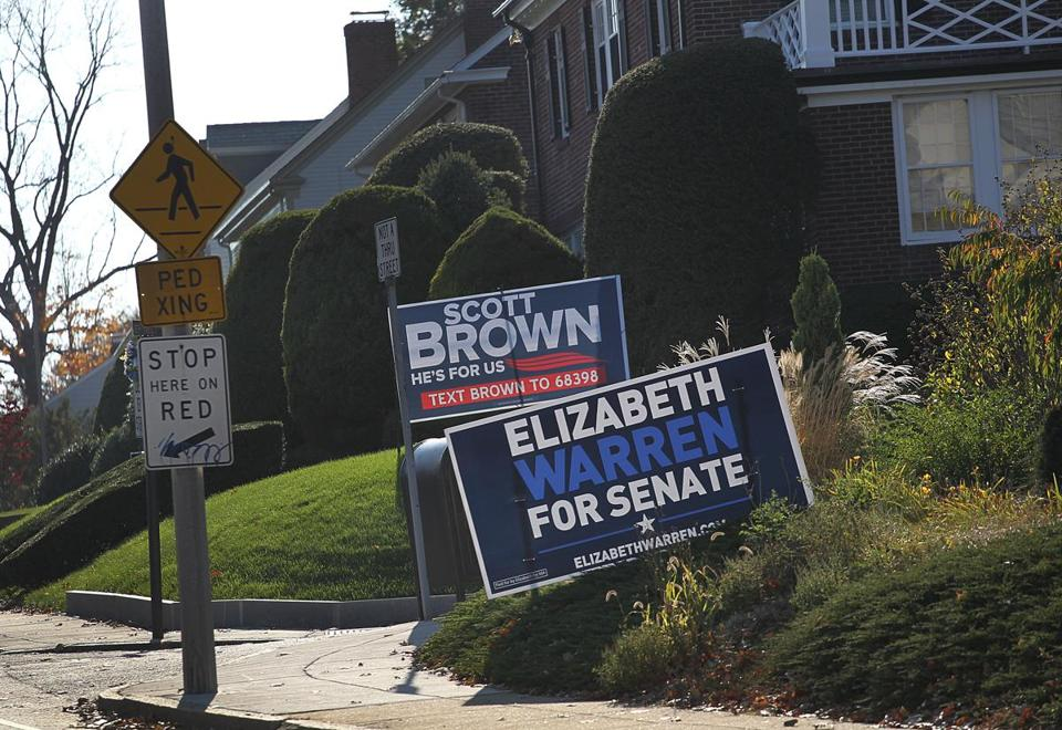 Jamaica Plain, MA., 10/26/12, Signs for Warren and Brown next to each other on Centre Street. Suzanne Kreiter/Globe staff