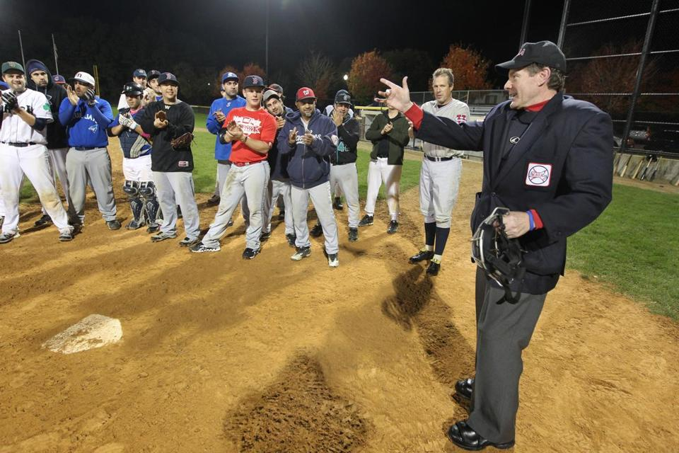 Umpire Walter Bentson, 58, who has a less aggressive form of ALS, is applauded by players during the ninth annual 100 Innings of Baseball game to benefit ALS research and the Angel Fund.