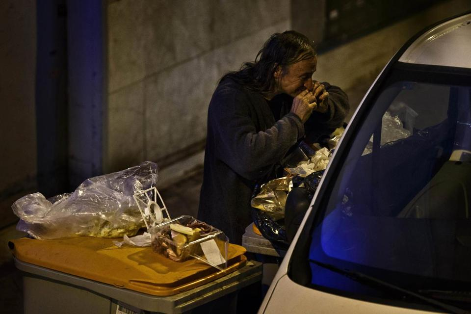 A man ate raw meat scavenged from the garbage at a market in Madrid. Spain has nearly 6 million unemployed.