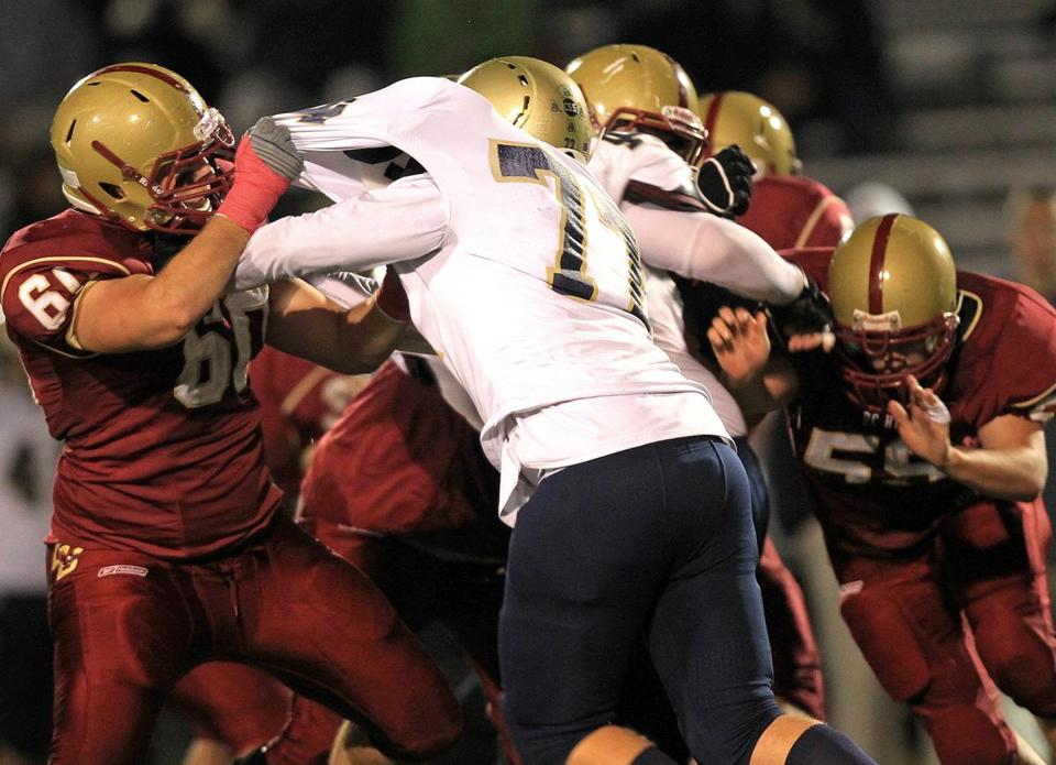 Football players and other athletes at Boston College High School, in the red uniform, sustained 63 head injuries.